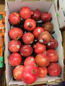 pomegranates in box