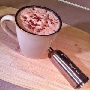Pour into a mug and garnish with chocolate and cinnamon