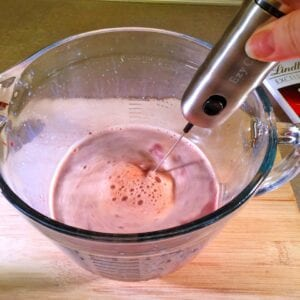Using a whisk or milk frother mix well