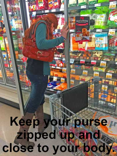 Hold your purse up against your body, keep it zipped or have the flap next to your body.