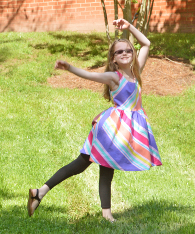 FabKids Summertime Party Outfit, striped skater dress, black Fab Soft leggings, black leather studded sandals